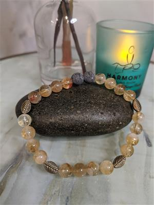 <p>One of our most popular stone bracelets! This gorgeous clear Citrine stone is eye catching and cheerful with a very high end look. Citrine is often associated with self-empowerment and prosperity. The uncoated lava stones and bronzed charms add a complimentary look to this pale yellow stone.</p>